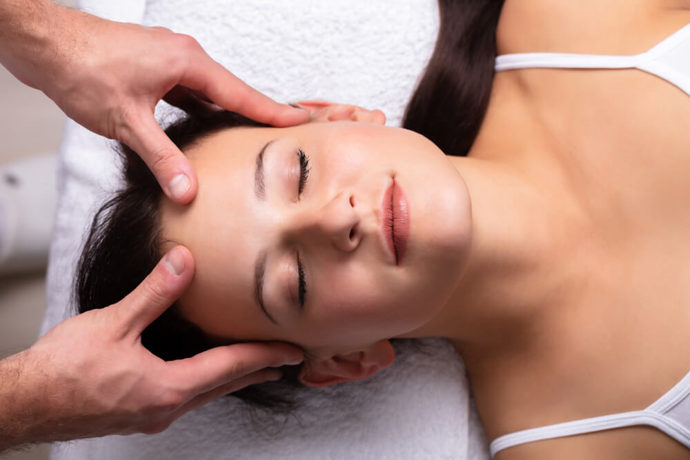 Lady getting massage by a professional therapist at a spa in egmore